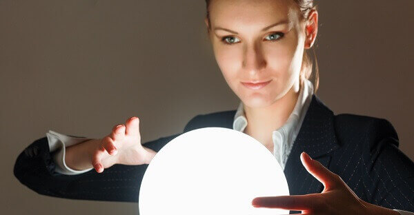 Woman in front of a glowing crystal orb.