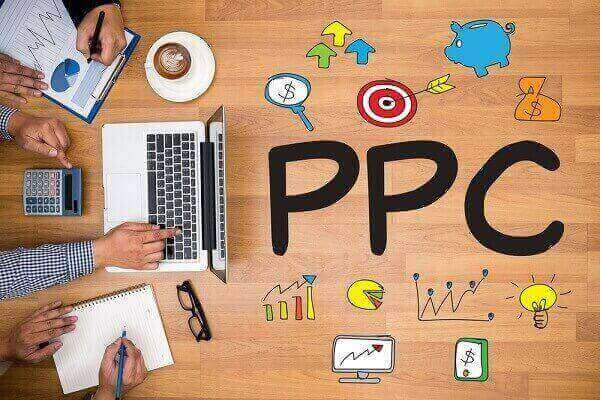 Graphic of PPC written on a desk, with a various people working around a laptop.