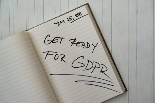 Open notebook, with 'get ready for gdpr' written in black ink.