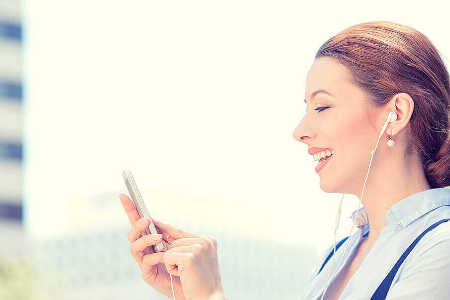 Lady holding a phone and smiling